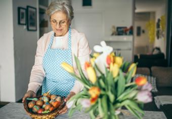 Senior woman with Easter basket and eggs