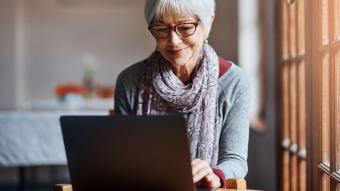 senior woman using a laptop at home