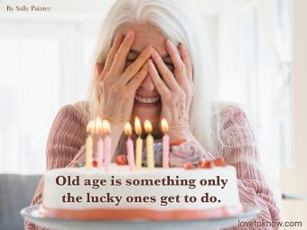 Senior woman with her birthday cake