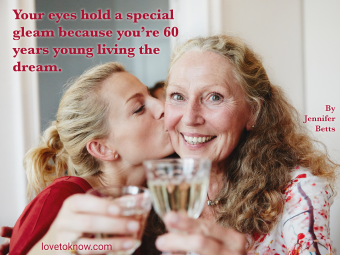 Happy family raising a glass of sparkling wine at a birthday party and turning 60 quote