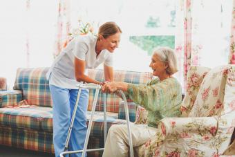 Caretaker assisting senior woman