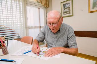 Senior Man Coloring An Adult Coloring Book
