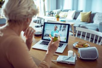 Senior Woman consulting with doctor online