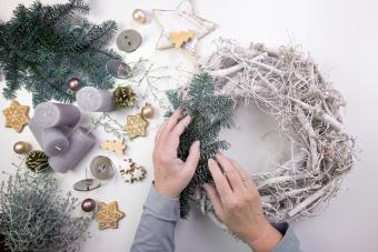 Older woman decorating a christmas wreath