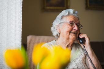 Portrait of an older woman talking with the phone