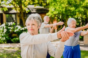 Senior women exercising in yard