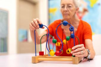 Old Woman exercise Alzheimer largest assisted living companies