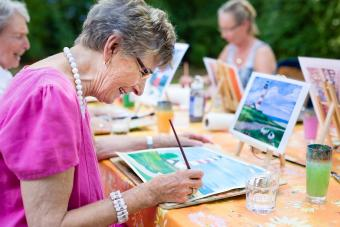 Senior woman drawing largest assisted living companies