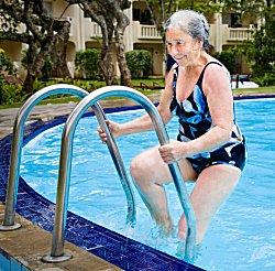 woman swimming in pool at senior apartment