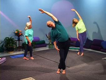 John Schlorholtz leads a group of yoga students