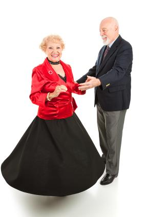 Retired couple having fun ballroom dancing