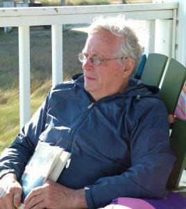 Senior man sitting on a porch