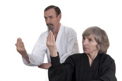 Seniors practicing martial arts