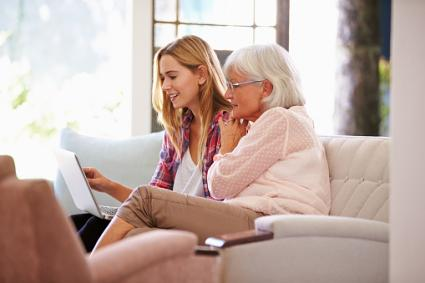 Adult Granddaughter Helping Grandmother With Computer