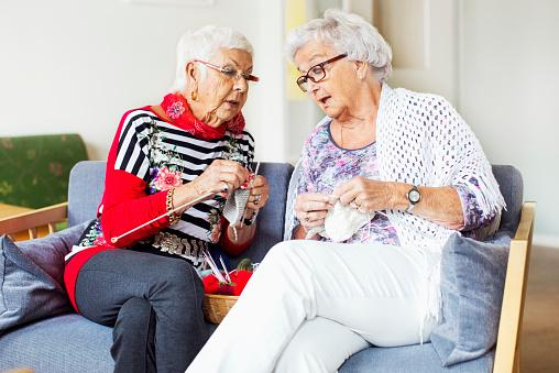 Senior women knitting