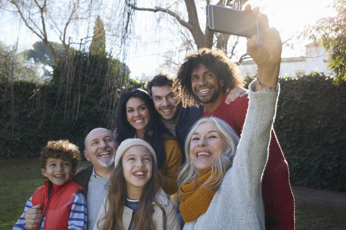 Happy multigenerational family taking selfie portrait