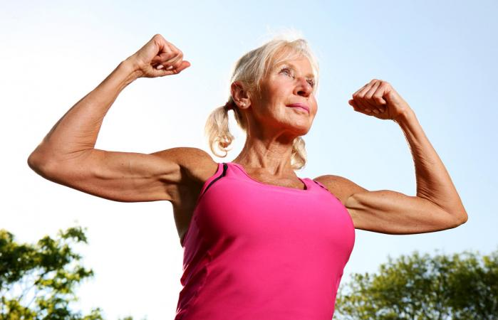 Older woman flexes muscles