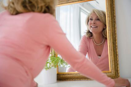 Woman admiring herself in mirror