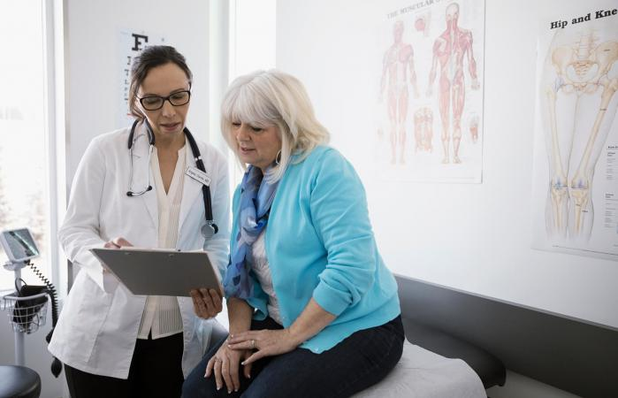 Doctor and senior patient reviewing medical chart