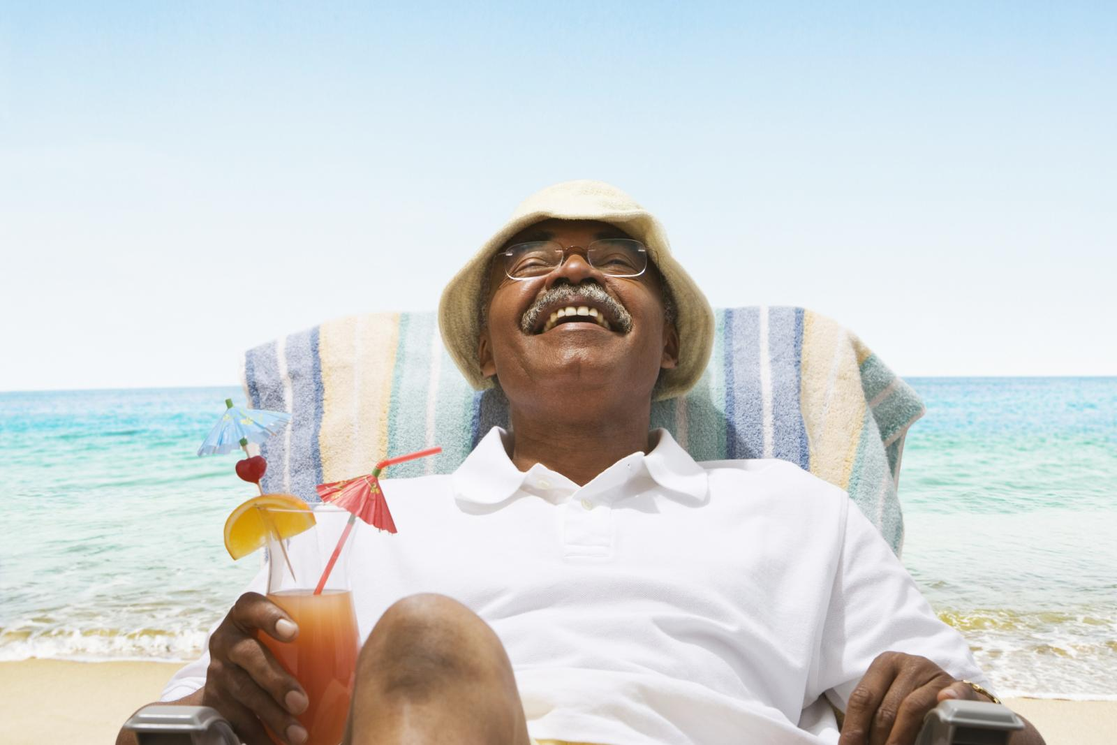 African American senior man relaxing at the beach