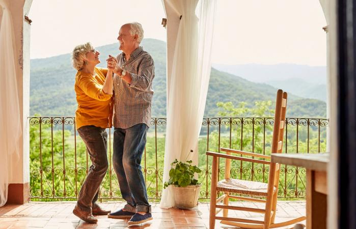 Senior couple dancing in balcony at home