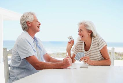 Couple playing cards with ocean view