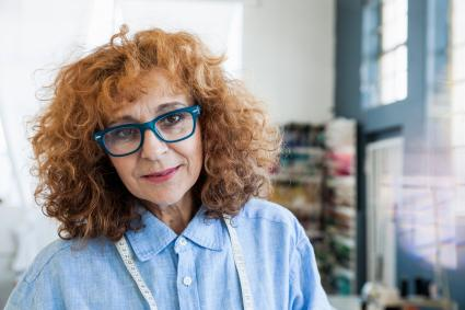 Woman with curly lob and glasses