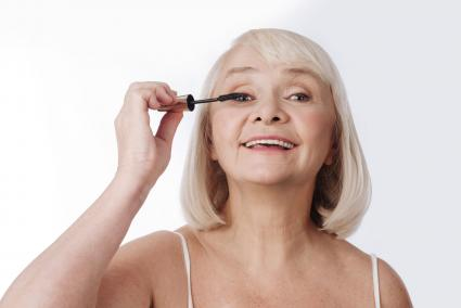 Woman using a mascara brush