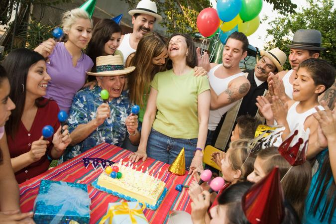 Woman celebrating 50th birthday with family