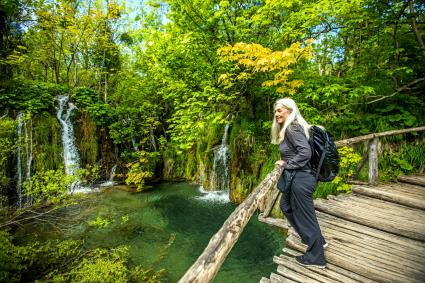 woman looking at beautiful waterfalls