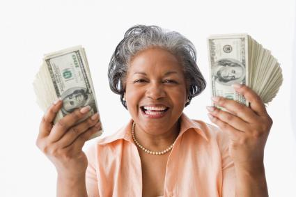 Portrait of senior woman holding money