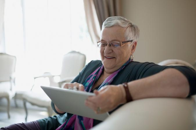 Senior woman playing mind games online