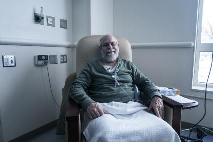 man receiving outpatient chemotherapy