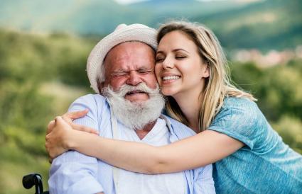 Woman hugging senior man