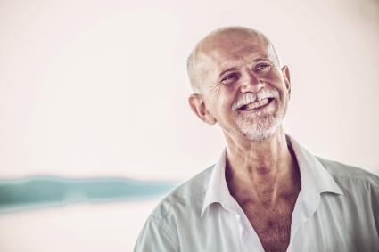 Cheerful Senior Man with white beard outdoors