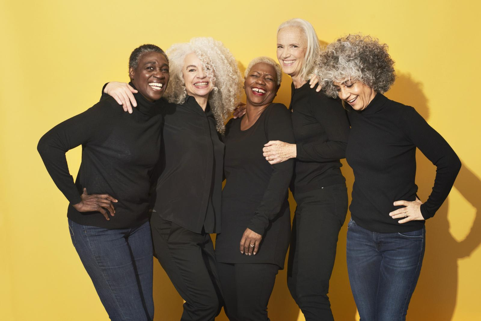 Portrait of five women with gray hair laughing and having fun