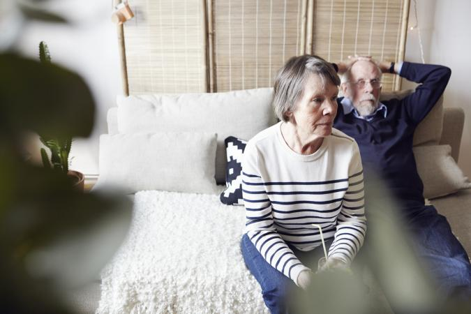 Senior couple sitting in living room