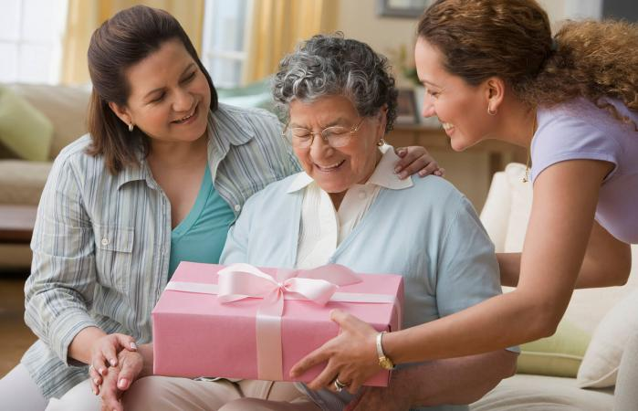 woman giving gift to grandmother