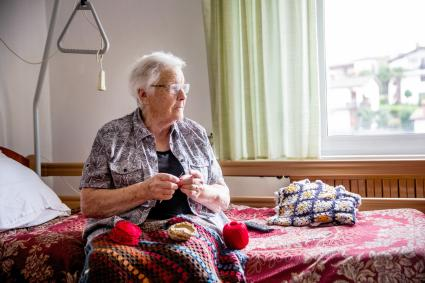 Senior crocheting in retirement home