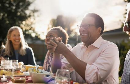 man enjoying garden party lunch with friends