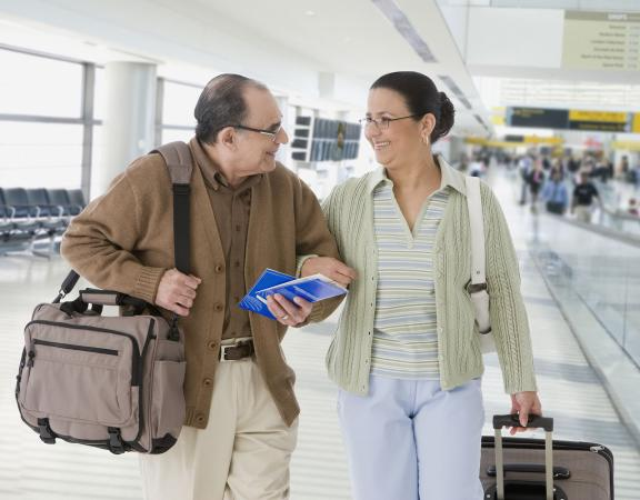 Elderly man traveling with helpful companion