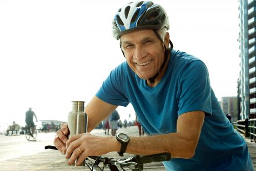 Senior man wearing bike helmet