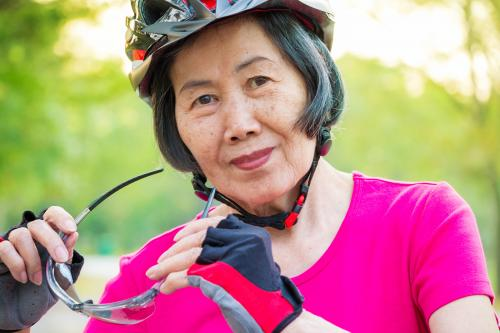 Senior woman wearing bike gloves