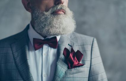 man wearing burgundy bow-tie