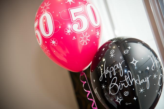 50th birthday pink and black balloons