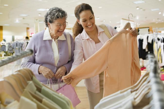 Senior woman and companion shopping for a blouse