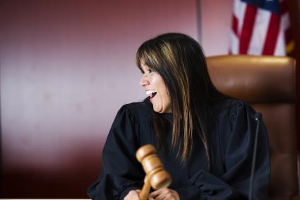 Female judge laughing