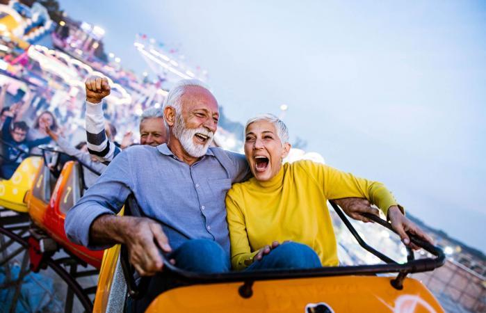 seniors having fun on rollercoaster