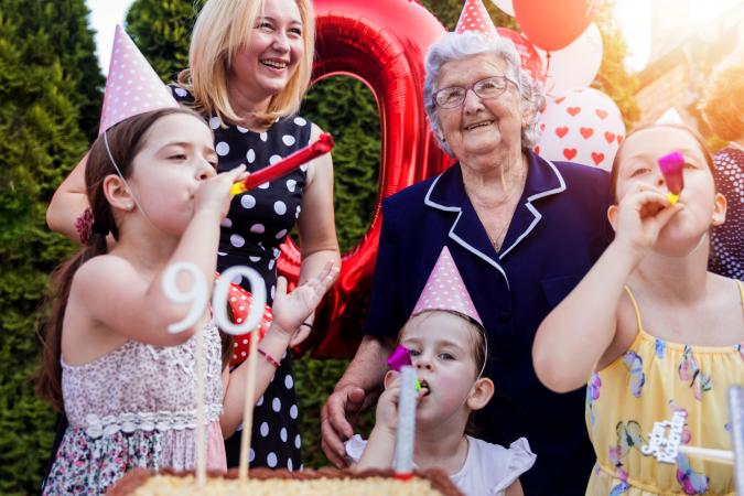 Happy kids celebrating grandmother's birthday