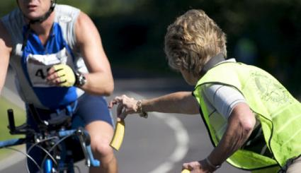 Image of a senior woman volunteering at a cycling event